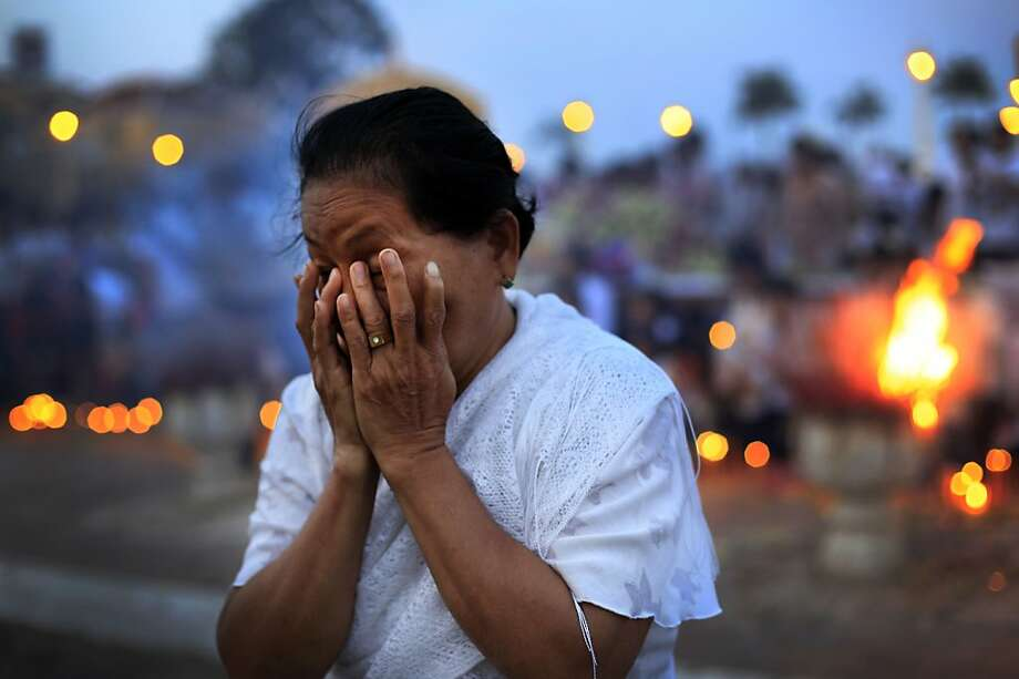 A Cambodian elderly lady wipes her tears as she mourns the death of her late King Norodom Sihanouk's, at the Royal Palace on Thursday Oct. 18, 2012 in Phnom Penh, Cambodia. The body of Sihanouk returned to his homeland on a plane from China on Wednesday, welcomed by tens of thousands of mourners who packed tree-lined roads in the Southeast Asian nation's capital ahead of the royal funeral.  Photo: Wong Maye-E, Associated Press