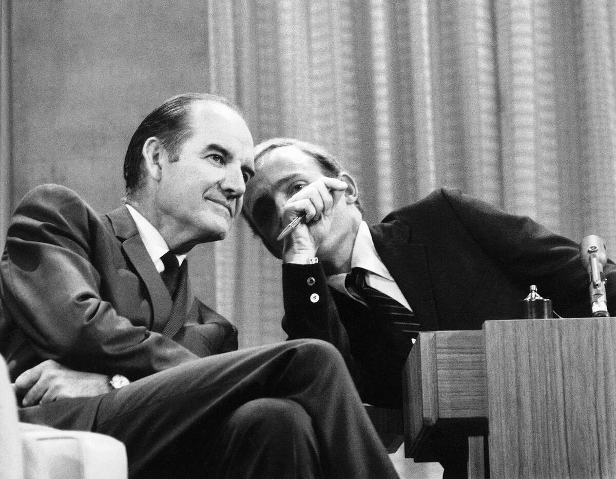 Sen. George McGovern of South Dakota listens attentively to TV host Dick Cavett, right, in New York, Aug. 12, 1968 during the taping of Cavettís television show for ABC-TV. McGovern said that his candidacy for the presidency, rather than dividing the Democratic peace delegates at the national convention, would be ìadding another ally to the peace soldiers.î (AP Photo)
