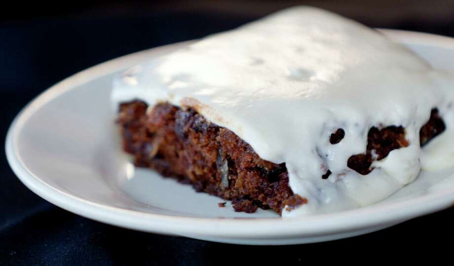 Another frequently cited place for making deals include with J. Alexander's.   Take a look at this carrot cake dessert from J. Alexander's. Photo: William Luther, San Antonio Express-News / © 2012 San Antonio Express-News