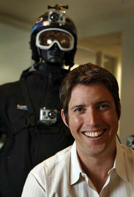 GoPro, Founder and CEO Nicholas Woodman is surrounded by dozens of variations of his GoPro cameras that are used by both pro and amateur photographers specializing is sports and recreation photography at his Half Moon Bay office Wednesday May, 4, 2011