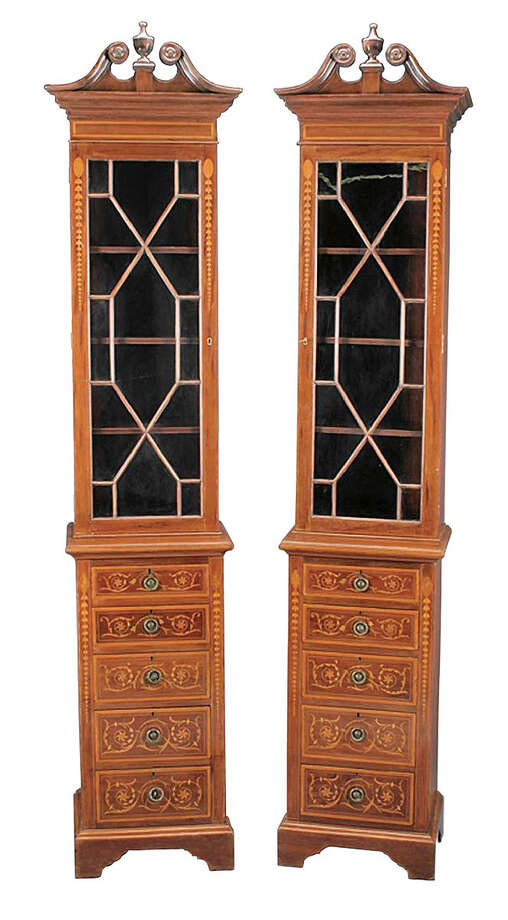 These two tall, narrow pieces of mahogany furniture are bookshelves. They would almost touch the ceiling in a traditional house today. Unusual furniture is sometimes hard to sell, but this pair sold at a Neal Auction in New Orleans for close to $3,000. Photo: Contributed Photo