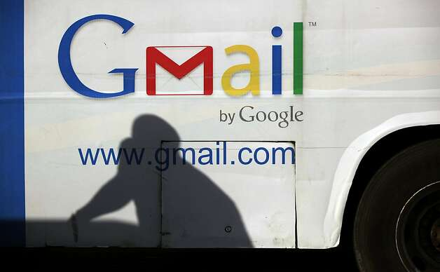 A commercial bus advertises Google Mail in Lagos, Nigeria. The company's stock plunged after an earnings report was inadvertently sent early. Photo: Sunday Alamba, Associated Press