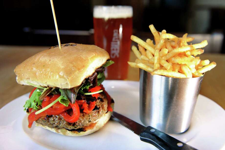 "The ""Something Greek"" burger with ground lamb, feta, mint, shallot with confit garlic, roasted red pepper slaw, served with fries and a pint of ""All In"" IPA on Tuesday, Oct. 16, 2012, at Druthers in Saratoga Springs, N.Y. (Cindy Schultz / Times Union) Photo: Cindy Schultz / 00019666A"