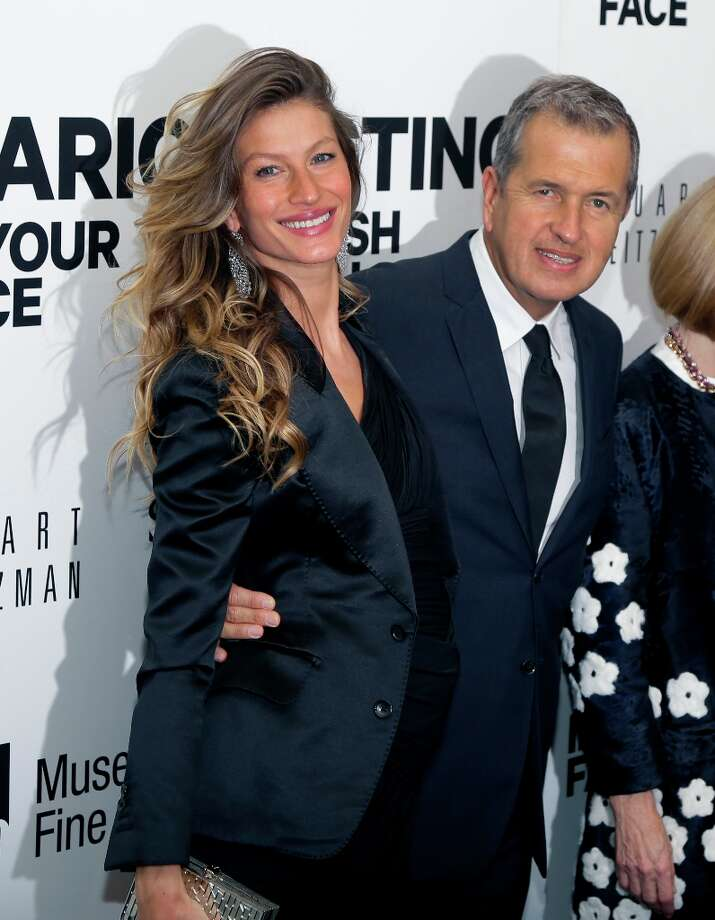 "Supermodel Gisele Bundchen poses with celebrity photographer Mario Testino prior to an evening reception at the Museum of Fine Arts in Boston Wednesday, Oct. 17, 2012 for the U.S. exhibitions of Testino's photographs ""In Your Face"" and ""British Royal Portraits."" Photo: Elise Amendola, Associated Press / AP"