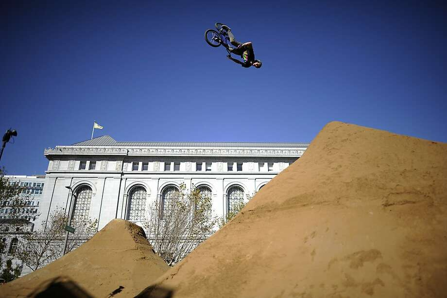 Participants in the Dew Tour BMX competition practice on large dirt jumps built in front of the Asian Art Museum. Photo: Michael Short, Special To The Chronicle