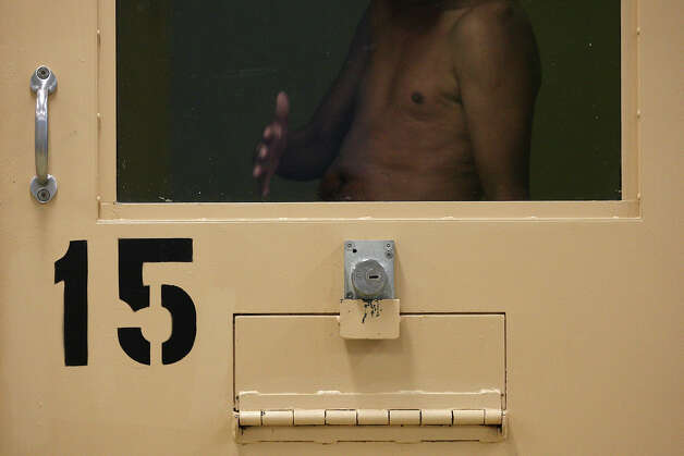 A Bexar County Jail inmate reacts to a media tour of the facilities, which have seen changes aimed at suicide prevention. Photo: Jerry Lara, San Antonio Express-News / © 2012 San Antonio Express-News