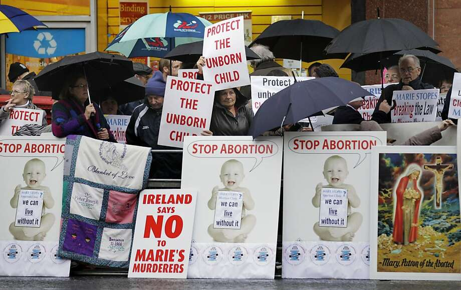 Protesters opposed to abortion hold placards outside the Marie Stopes clinic in Belfast, Northern Ireland. It's the first abortion clinic on the island of Ireland. Photo: Peter Morrison, Associated Press