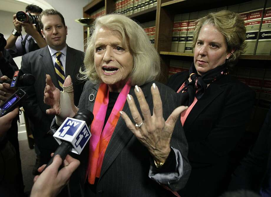 Edith Windsor, center, is interviewed at the offices of the New York Civil Liberties Union, in New York, Thursday, Oct. 18, 2012. A federal appeals court in Manhattan has become the second in the nation to strike down the Defense of Marriage Act as unconstitutional. The ruling came in a case brought by Windsor. She sued the government in November 2010 because she was told to pay $363,053 in federal estate tax after her partner of 44 years died in 2009. Her attorney Roberta Kaplan is at right. (AP Photo/Richard Drew) Photo: Richard Drew, Associated Press