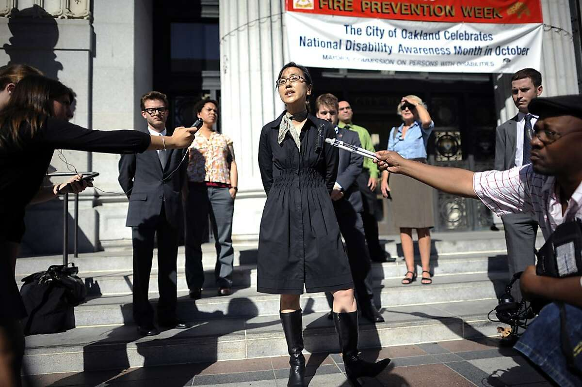 ACLU staff attorney Linda Lye(center) makes a statement to reporters on the steps of City Hall in Oakland about her groups opposition to Alameda County's proposed use of surveillance drones for local law enforcement. Oakland, CA Thursday October 18th, 2012