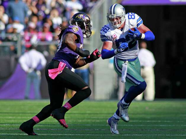 With two minutes left, Dallas Cowboys tight end Jason Witten (82) gets a much-needed first down for the Cowboys as Baltimore Ravens linebacker Dannell Ellerbe (59) forces Witten out of bounds at the 43 yard line. In NFL football action, the Dallas Cowboys lose to the Baltimore Ravens, 31-29 in Baltimore, Maryland, Sunday, October 14, 2012. (Paul Moseley/Fort Worth Star-Telegram/MCT) Photo: Paul Moseley, McClatchy-Tribune News Service / Fort Worth Star-Telegram