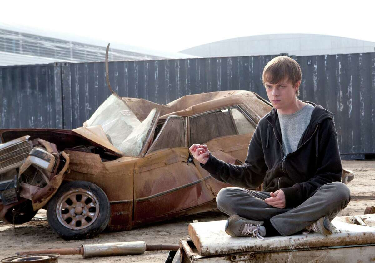 """In this film image released by 20th Century Fox, Dane DeHaan is shown in a scene from """"Chronicle."""" (AP Photo/20th Century Fox, Alan Markfield) DF-05338 - Andrew (Dane DeHaan) succumbs to his darker nature as his telekinetic powers become stronger."""