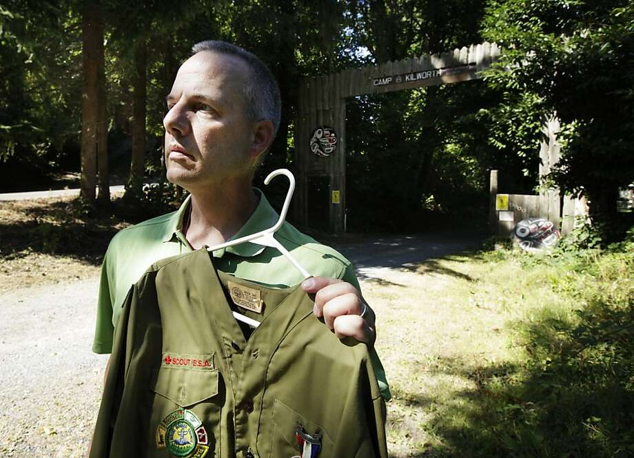 Tom Stewart, who says he was abused as a Boy Scout, holds his uniform outside the Boy Scout Camp Kilworth in Washington. Photo: Ted S. Warren, Associated Press