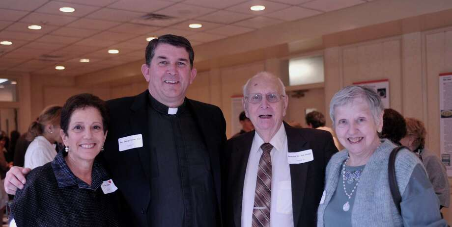Ellen Umansky and The Rev. George Collins of Fairfield University, left, stand with Reverends Don and Arlene Studer, retired clergy from First Church Congregational, during a recent sukkot luncheon at Congregation Beth El to benefit Fairfield homeless shelter Operation Hope. Collins gave the invocation for the luncheon held on Thursday, Oct. 4. Photo: Contributed Photo/Seth Block / (c)Seth Block