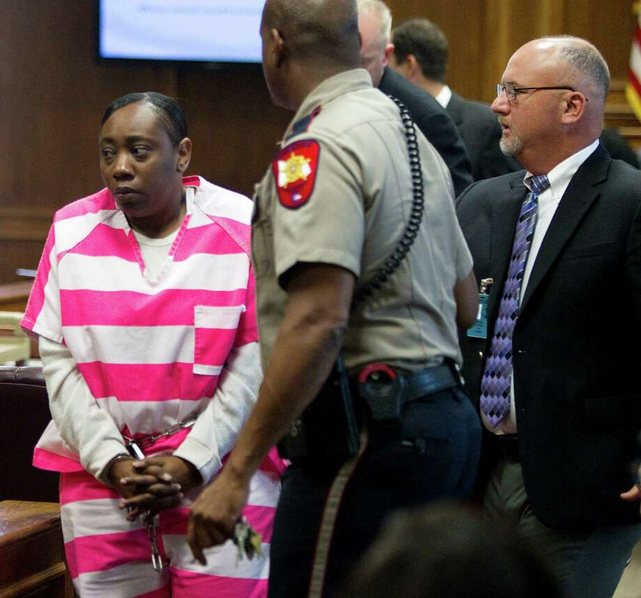 Verna McClain, left, leaves the courtroom with her attorney, Tay Bond, after a hearing in May. ( Brett Coomer / Houston Chronicle ) Photo: Brett Coomer / © 2012 Houston Chronicle