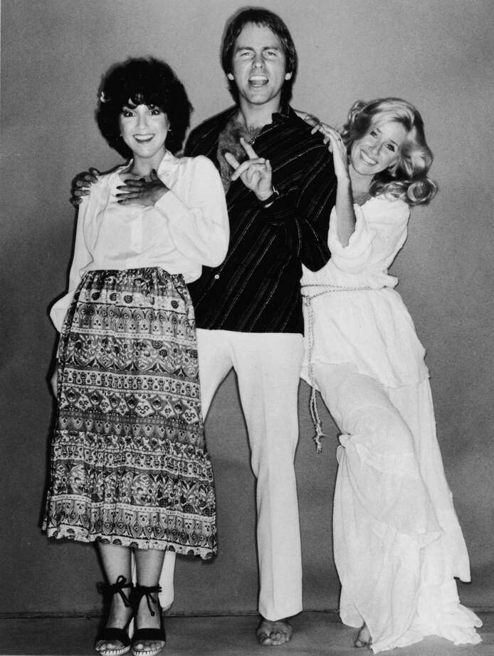 "Suzanne Somers (R) and Joyce DeWitt (L) played everyone's favorite jiggly babes in ""Three's Company,"" which debuted in 1977. It also starred John Ritter (center).  Photo: Hulton Archive, Getty Images / Hulton Archive"