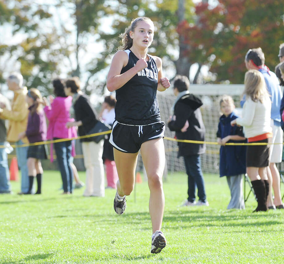 Fairfield-Warde High School runner Cate Allen finishes first during the FCIAC girls high school cross country championship at Waveny Park in New Canaan, Thursday afternoon, Oct. 18, 2012. Photo: Bob Luckey / Greenwich Time