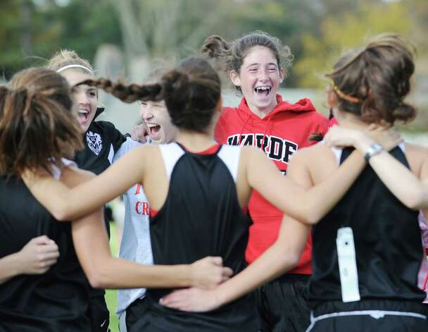 Fairfield-Warde High School does a cheer prior to the start of the FCIAC girls high school cross country championship at Waveny Park in New Canaan, Thursday afternoon, Oct. 18, 2012. Photo: Bob Luckey / Greenwich Time