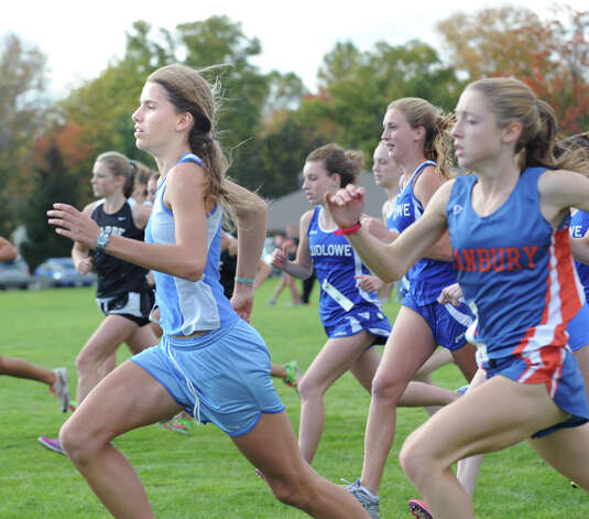 At left, Anne Johnston of Darien High School at the start of the FCIAC girls high school cross country championship at Waveny Park in New Canaan, Thursday afternoon, Oct. 18, 2012. Photo: Bob Luckey / Greenwich Time