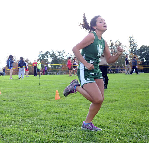 Natalia Dedios of Nowalk High School nears the finish line during the FCIAC girls high school cross country championship at Waveny Park in New Canaan, Thursday afternoon, Oct. 18, 2012. Photo: Bob Luckey / Greenwich Time