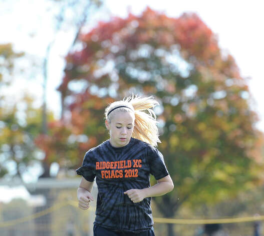 Leah Phelan of Ridgefield High School warms-up prior to the start of the FCIAC girls high school cross country championship at Waveny Park in New Canaan, Thursday afternoon, Oct. 18, 2012. Photo: Bob Luckey / Greenwich Time