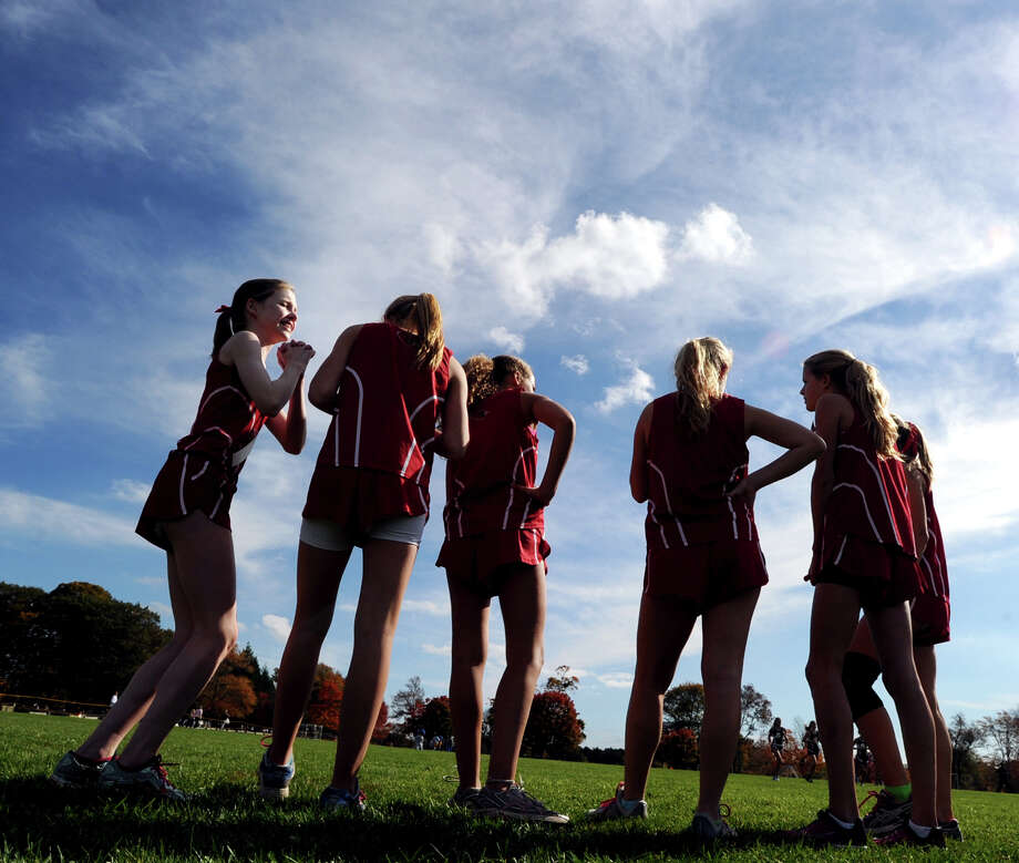 Greenwich High School runner Page Dabney, left, prior to the start of one of the FCIAC girls high school cross country championship races at Waveny Park in New Canaan, Thursday afternoon, Oct. 18, 2012. Photo: Bob Luckey / Greenwich Time