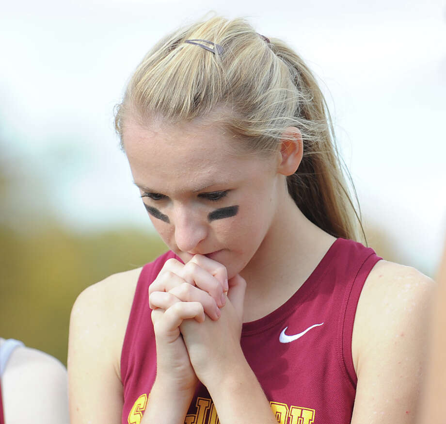 A pensive Erin Hurd of St. Joseph High School prior to the start of the FCIAC girls high school cross country championship at Waveny Park in New Canaan, Thursday afternoon, Oct. 18, 2012. Photo: Bob Luckey / Greenwich Time