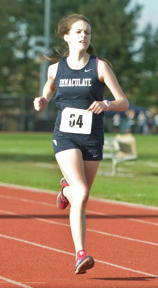 Immaculate High School's Carly Schuyler finishing second in the SWC girls cross country championship at Bethel. Thursday, Oct. 18, 2012 Photo: Scott Mullin