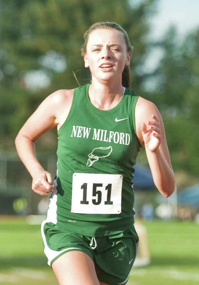 New Milford High School's Jessica Noteware in the SWC girls cross country championship at Bethel. Thursday, Oct. 18, 2012 Photo: Scott Mullin