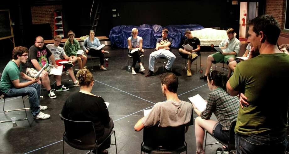 """The cast of Fairfield UniversityâÄôs resident production company, Theatre Fairfield, rehearses for its production of the political drama """"An Enemey of the People. The company will open its 2012-2013 theatrical season with performances of the play from Wednesday, Oct. 31, through Sunday, Nov. 4. Photo: Contributed Photo"""