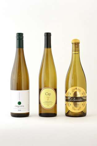 Three bottles of Sauvignon Blanc: 2011 Origine RRV Sauvingon Blanc, 2011 Cep Hopkins Ranch RRV Sauvignon Blanc, 2011 Brander Santa Ynez Valley Sauvignon Au Natural as seen in San Francisco, California on Wednesday, October 17, 2012. Photo: Craig Lee, Special To The Chronicle