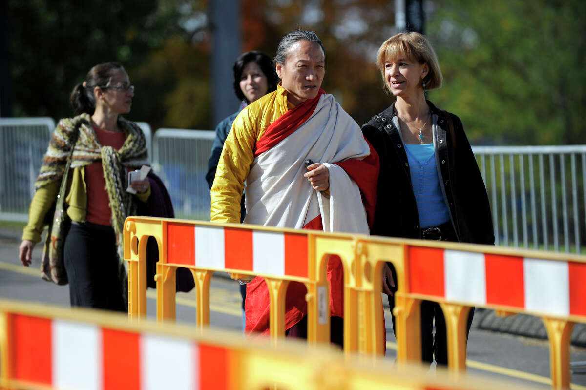 People arrive at the O'Neill Center at Western Connecticut State University Thursday morning for the first day of a two-day visit of the Dalai Lama, Oct. 18, 2012.
