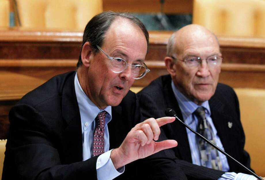 Erskine Bowles, left, accompanied by former Wyoming Sen. Alan Simpson, co-chairmen of President Barack Obama's bipartisan deficit commission, gestures while speaking on Capitol Hill in Washington Wednesday, Nov. 10, 2010.(AP Photo/Alex Brandon) Photo: Alex Brandon / AP