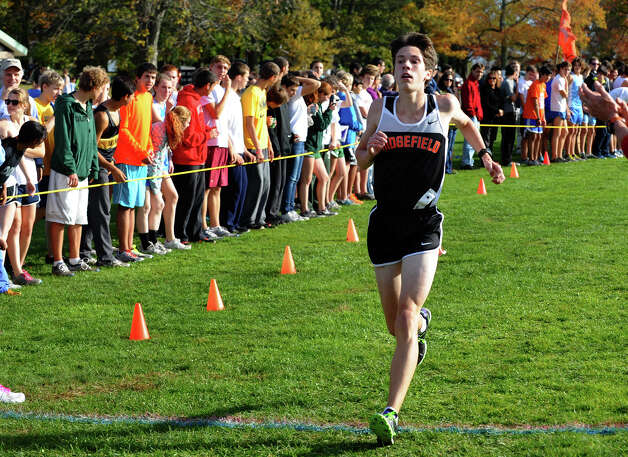 Ridgefield's Trevor Hopper crosses the finish line for second place, during boys FCIAC cross country action at Wavenly Park in New Canaan, Conn. on Thursday October 18, 2012. Photo: Christian Abraham / Connecticut Post