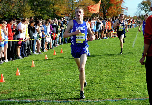 Darien's Marshall Huffman crosses the finish line, during boys FCIAC cross country action at Wavenly Park in New Canaan, Conn. on Thursday October 18, 2012. Photo: Christian Abraham / Connecticut Post