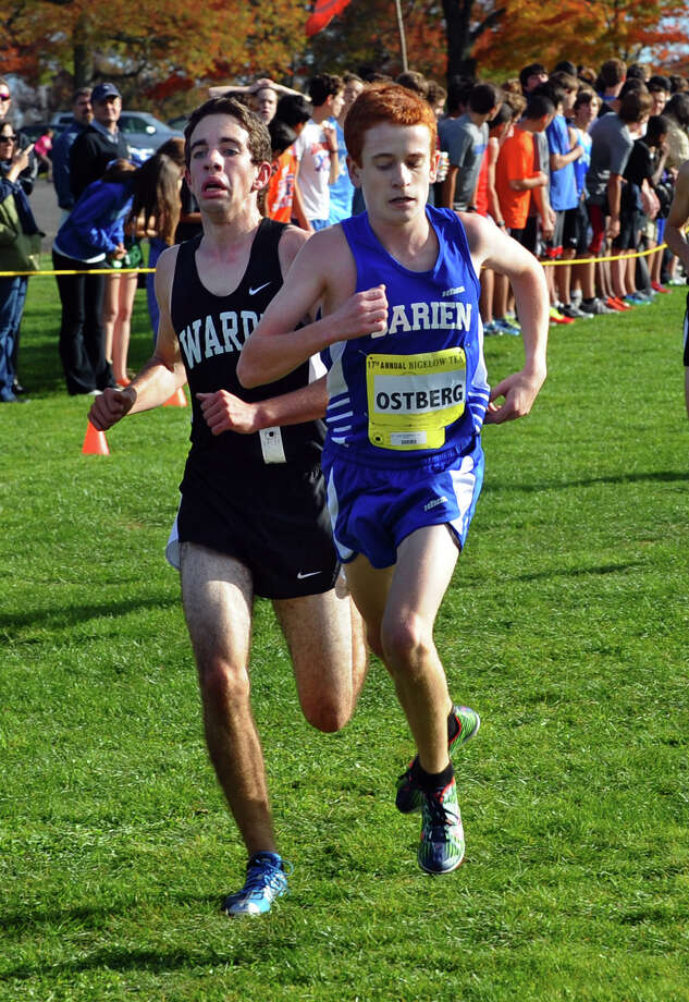 Fairfield Warde's Aidan Fiol, left, and Darien's Alex Ostberg arrive neck and neck to the finish line, during boys FCIAC cross country action at Wavenly Park in New Canaan, Conn. on Thursday October 18, 2012. Photo: Christian Abraham / Connecticut Post