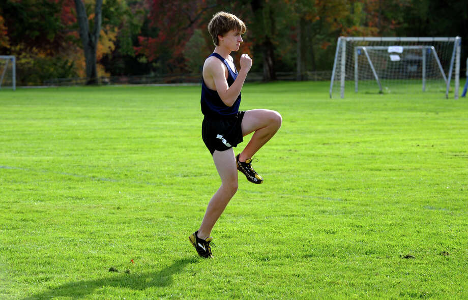 Wilton's Kristian Langholm warms up before the start of boys FCIAC cross country action at Wavenly Park in New Canaan, Conn. on Thursday October 18, 2012. Photo: Christian Abraham / Connecticut Post
