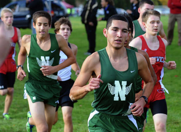 Norwalk's Edwin Rosales and Christian Bonebreak, in back, take part in boys FCIAC cross country action at Wavenly Park in New Canaan, Conn. on Thursday October 18, 2012. Photo: Christian Abraham / Connecticut Post