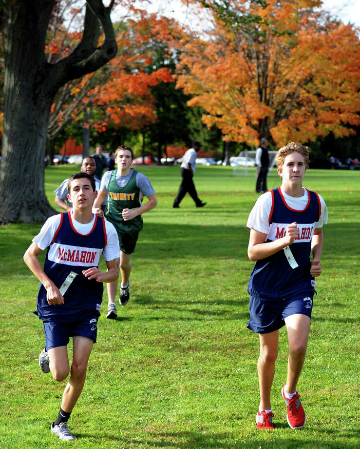 Brien McMahon's Brendan Walsh, left, and teammate Deegan Reeves take part in boys FCIAC cross country action at Wavenly Park in New Canaan, Conn. on Thursday October 18, 2012. Photo: Christian Abraham / Connecticut Post