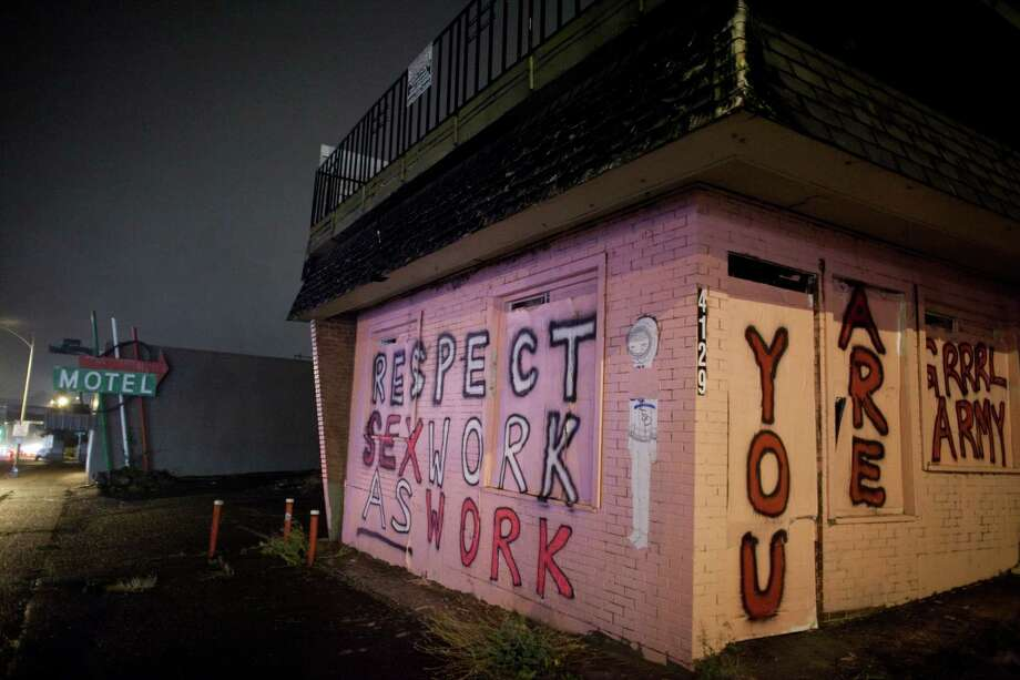 The former Italia Motel is shown after a group known as the Seattle Grrrl Army painted messages on the former troubled motel on Aurora Avenue North in Seattle. The graffiti is shown on Tuesday, October 16, 2012. Photo: JOSHUA TRUJILLO / SEATTLEPI.COM