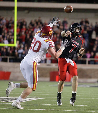 Texas Tech's Seth Doege (7) throws under pressure from Iowa State's Jake Knott (20) during an NCAA college football game in Lubbock, Texas, Saturday, Oct. 29, 2011. (AP Photo/Lubbock Avalanche-Journal, Stephen Spillman) Photo: Stephen Spillman, Associated Press / AP