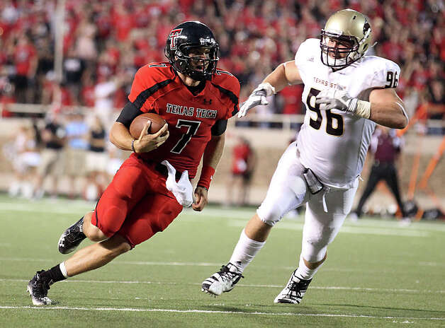 Texas Tech's Seth Doege finds running room ahead of Texas State's Michael Ebbitt during their NCAA college football game at Jones AT&T Stadium in Lubbock, Texas, Saturday, Sept. 3, 2011. (AP Photo/Lubbock Avalanche-Journal, Zach Long) Photo: Zach Long, Associated Press / Lubbock Avalanche-Journal