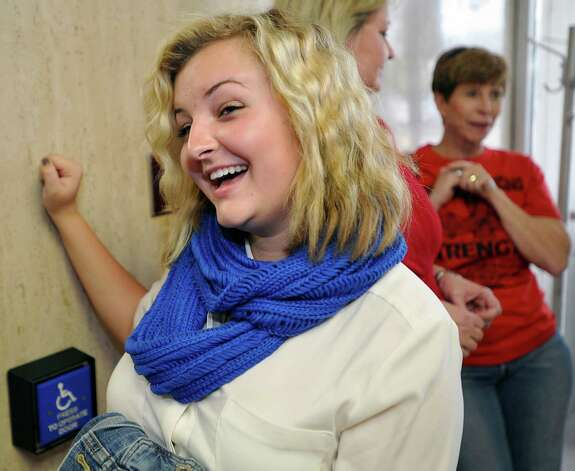 Cheerleader Rebekah Richardson is all smiles Thursday after the judge's decision to let her squad continue using Scripture-based banners at football games. Photo: Dave Ryan