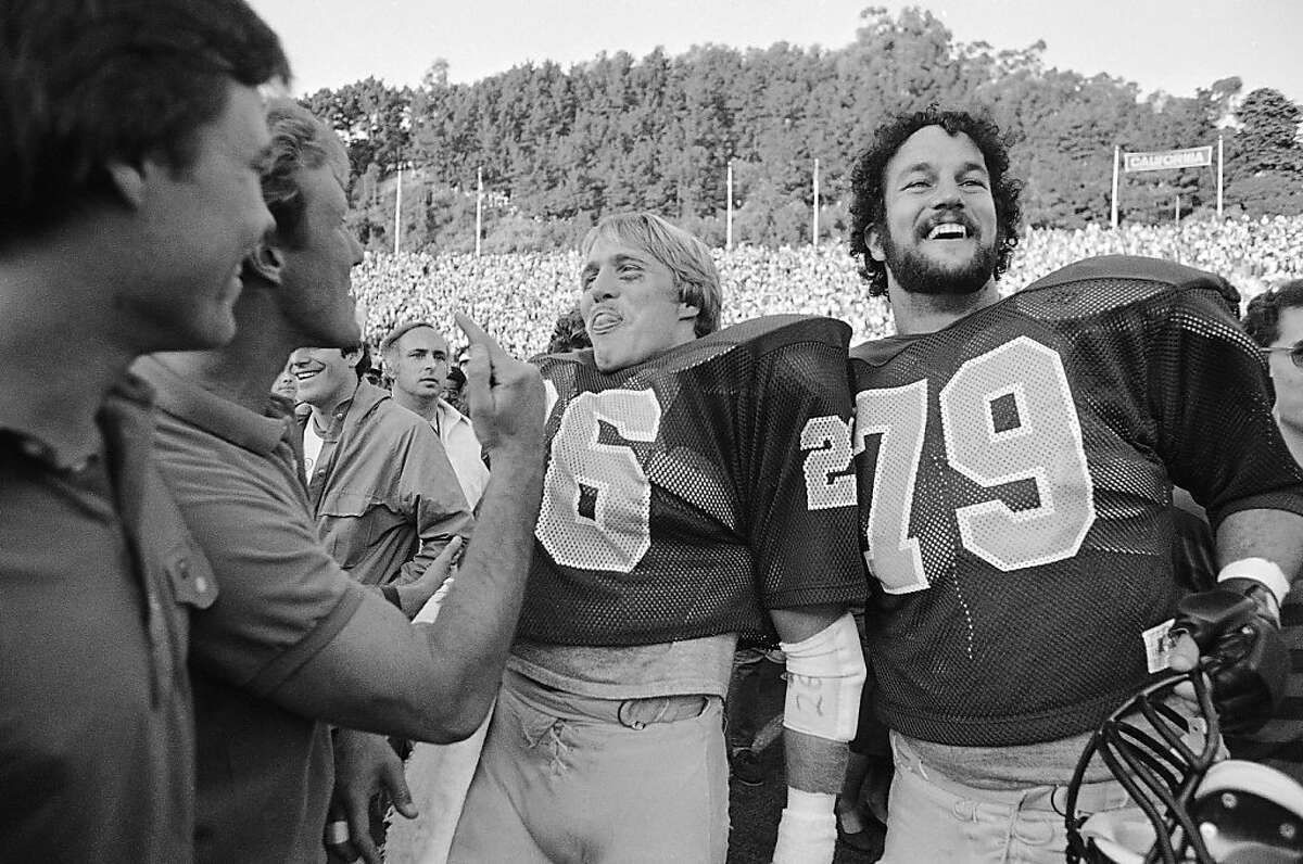 Cal's Kevin Moen center (26), and Ricardo Stelzmiller (79) are all smiles after Cal defeated Stanford, 25-20 on Nov. 20, 1982 in Berkeley. Cal's Kevin Moen weaved his way through hundreds of people and scored a touchdown after time had run out to give Cal the win. (AP Photo/Carl Viti)