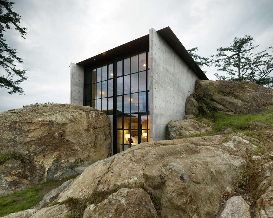 """We'll start with The Pierre, a residence in the San Juan Islands, designed by Olson Kundig Architects of Seattle. According to a project writeup: """"The Pierre, French word for 'stone,' is a 2,500-square-foot residence inspired by the owner's affection for a stone outcropping on her property and the views from the site.Conceived as a bunker nestled into the rock, from certain angles the house – with its rough materials, green roof, and surrounding lush foliage – almost disappears into nature."""" Photo: Courtesy American Institute Of Architects Northwest And Pacific Region/Olson Kundig Architects"""