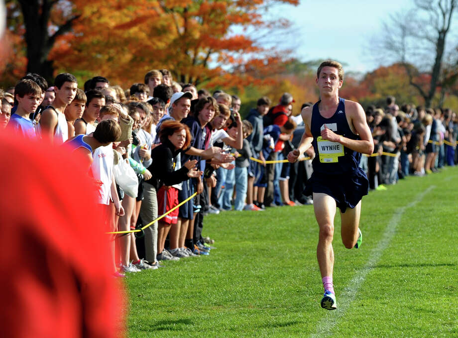 Staples' Henry Wynne cruises towards the finish line for first place, during boys FCIAC cross country action at Wavenly Park in New Canaan, Conn. on Thursday October 18, 2012. Photo: Christian Abraham / Connecticut Post