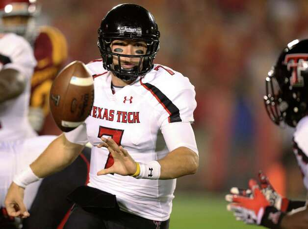 Texas Tech quarterback Seth Doege (7) flips the ball to wide receiver SaDale Foster, right, during the second half of an NCAA college football game against Iowa State, Saturday, Sept. 29, 2012, in Ames, Iowa. Texas Tech won 24-13. (AP Photo/Justin Hayworth) Photo: Justin Hayworth, Associated Press / FR170760 AP