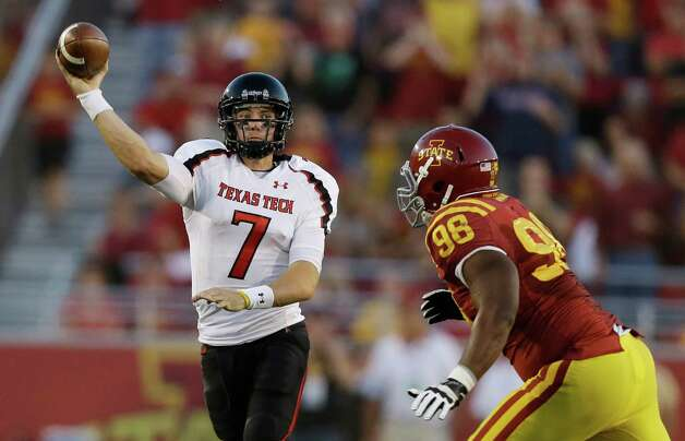 Texas Tech quarterback Seth Doege, left, passes over Iowa State defensive lineman Henry Simon during the first half of an NCAA college football game, Saturday, Sept. 29, 2012, in Ames, Iowa. (AP Photo/Charlie Neibergall) Photo: Charlie Neibergall, Associated Press / AP