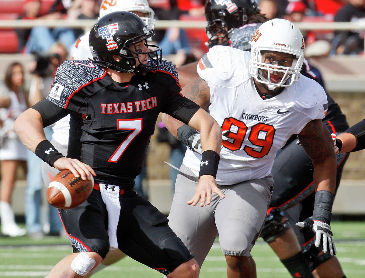 Texas Tech quarterback Seth Doege (7) looks for a receiver under pressure from Oklahoma State defensive tackle Richetti Jones (99) in the third quarter of an NCAA college football game in Lubbock, Texas, Saturday, Nov. 12, 2011. Oklahoma State won 66-6. (AP Photo/Sue Ogrocki)