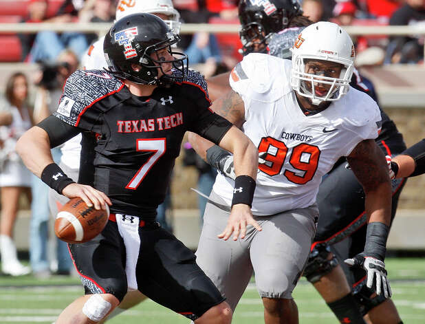 Texas Tech quarterback Seth Doege (7) looks for a receiver under pressure from Oklahoma State defensive tackle Richetti Jones (99) in the third quarter of an NCAA college football game in Lubbock, Texas, Saturday, Nov. 12, 2011. Oklahoma State won 66-6. (AP Photo/Sue Ogrocki) Photo: Sue Ogrocki, Associated Press / AP