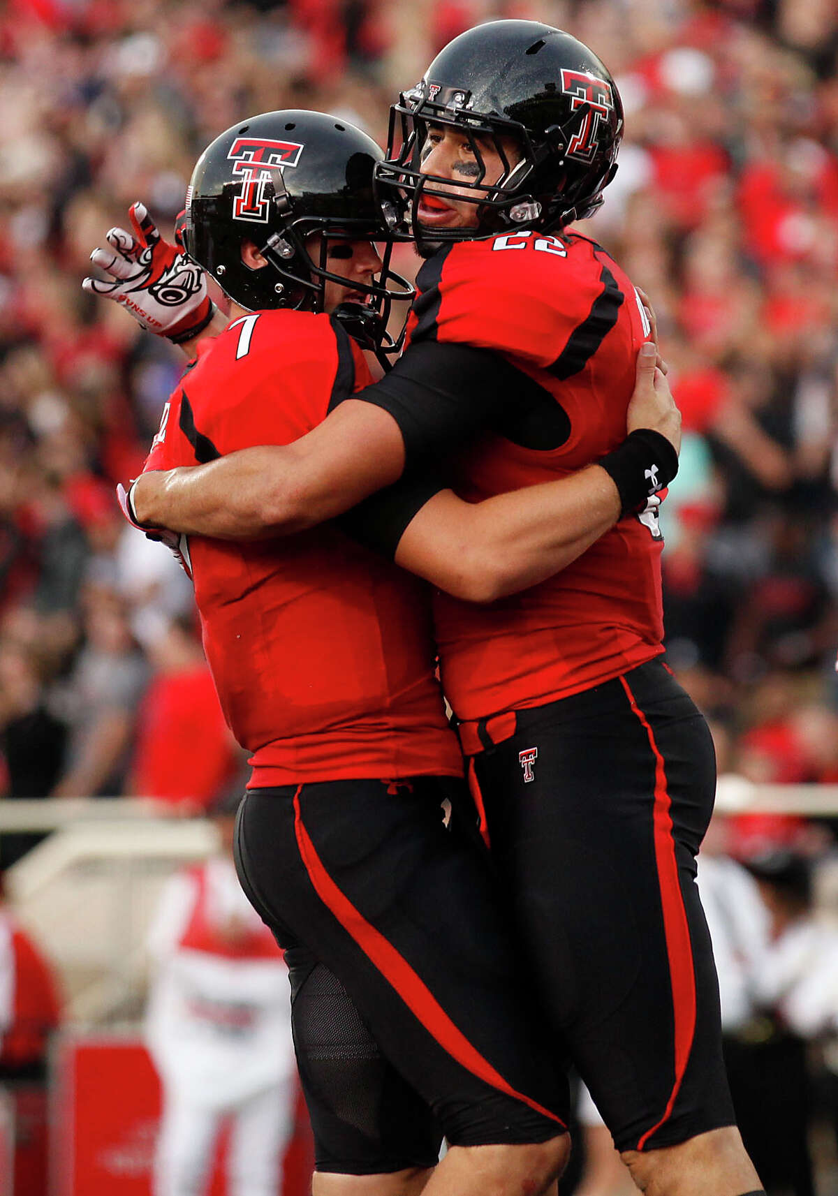 Texas Tech's Seth Doege (7) and Jace Amaro (22) celebrate a touchdown against New Mexico during an NCAA college football game in Lubbock, Texas, Saturday, Sept. 15, 2012. (AP Photo/Lubbock Avalanche-Journal, Stephen Spillman) Texas Tech